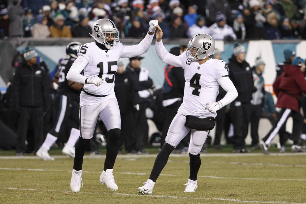 Oakland Raiders' Derek Carr, right, celebrates with Michael Crabtree after Carr passed for a touchdown during the first half of an NFL football game against the Philadelphia Eagles, Monday, Dec. 2 ...