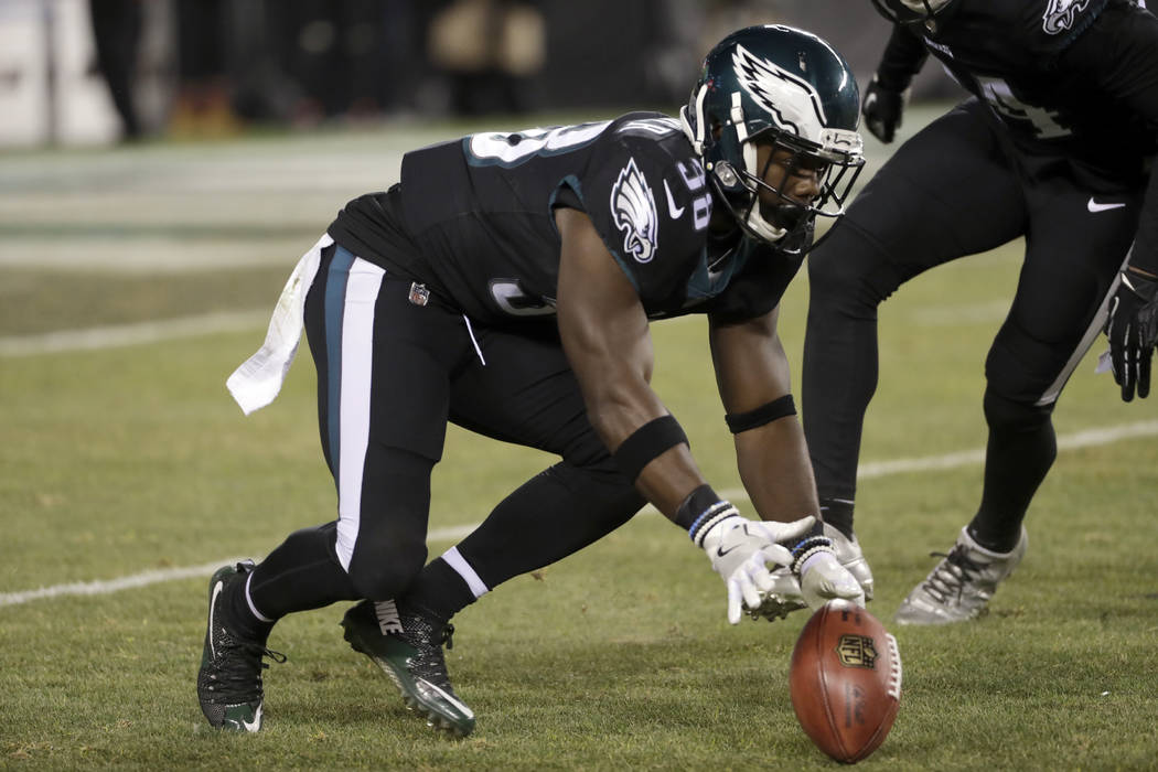 Philadelphia Eagles' Kenjon Barner chases a loose punt during the second half of an NFL football game against the Oakland Raiders, Monday, Dec. 25, 2017, in Philadelphia. (AP Photo/Michael Perez)