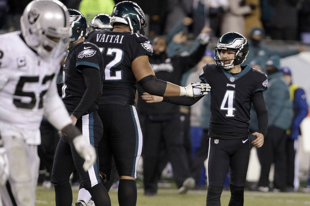 Philadelphia Eagles' Jake Elliott (4) and Halapoulivaati Vaitai celebrate after Elliott's field goal during the second half of an NFL football game against the Oakland Raiders, Monday, Dec. 25, 20 ...