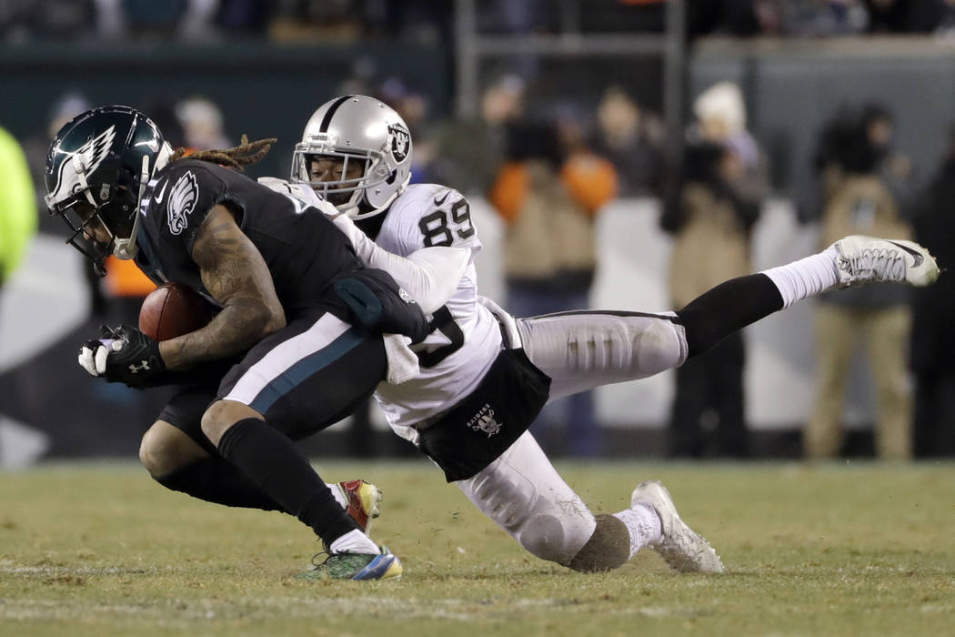 Philadelphia Eagles' Ronald Darby, left, intercepts a pass against Oakland Raiders' Amari Cooper (89) during the second half of an NFL football game, Monday, Dec. 25, 2017, in Philadelphia. (AP Ph ...