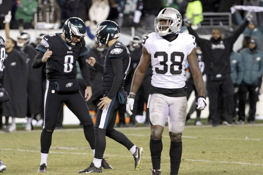 Philadelphia Eagles' Jake Elliott (4) and Donnie Jones (8) celebrate past Oakland Raiders' T.J. Carrie (38) after Elliott's field goal during the second half of an NFL football game, Monday, Dec.  ...