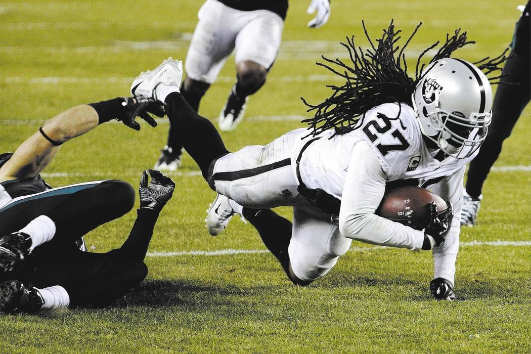 Oakland Raiders' Reggie Nelson, right, is tackled by Philadelphia Eagles' Zach Ertz after Nelson caught an interception during the second half of an NFL football game, Monday, Dec. 25, 2017, in Ph ...