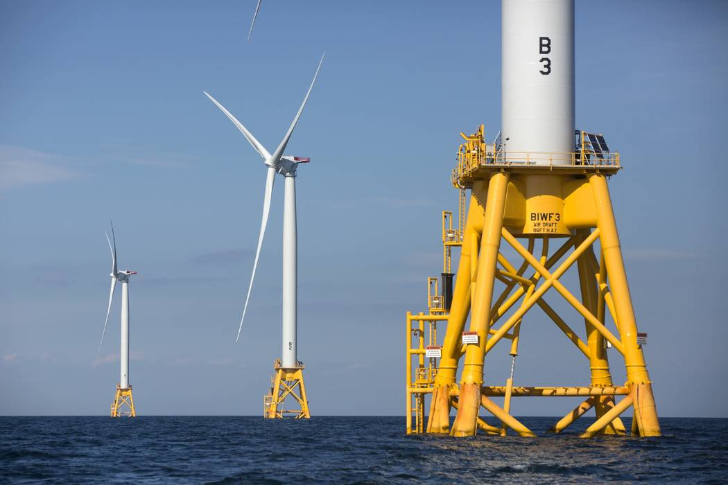 FILE - In this Monday, Aug. 15, 2016, file photo three wind turbines from the Deepwater Wind project stand in the Atlantic Ocean off Block Island, R.I. Fishermen are turning a wary eye toward an e ...