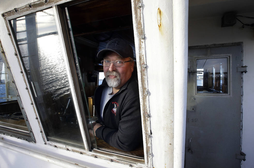 "In this Wednesday, Dec. 6, 2017 photo scallop fisherman Eric Hansen, of Marion, Mass., stands for a photo aboard his fishing vessel ""Endeavor,"" in Fairhaven, Mass. Fishermen in t ..."