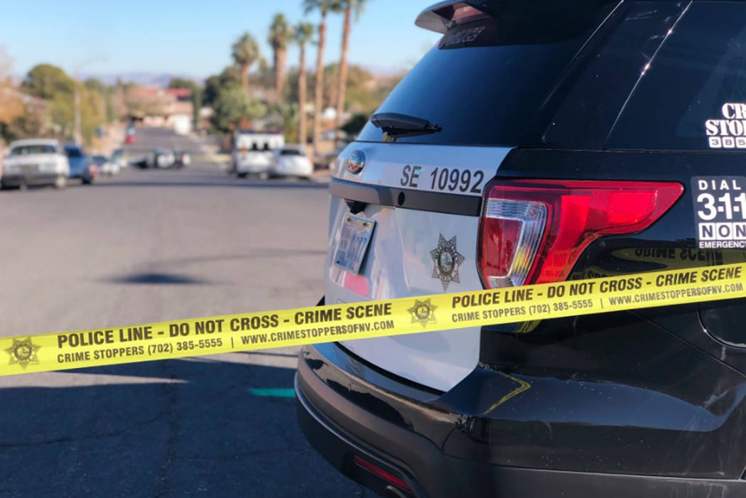 Las Vegas police investigate after two people were found dead Dec. 22 inside an eastern valley home. (Rio Lacanlale/Las Vegas Review-Journal)