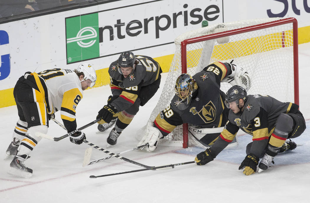 Golden Knights goaltender Marc-Andre Fleury (29) makes a save against Penguins right wing Phil Kessel (81) during the third period of Vegas' home matchup with Pittsburgh on Thursday, Dec. 14, 2017 ...