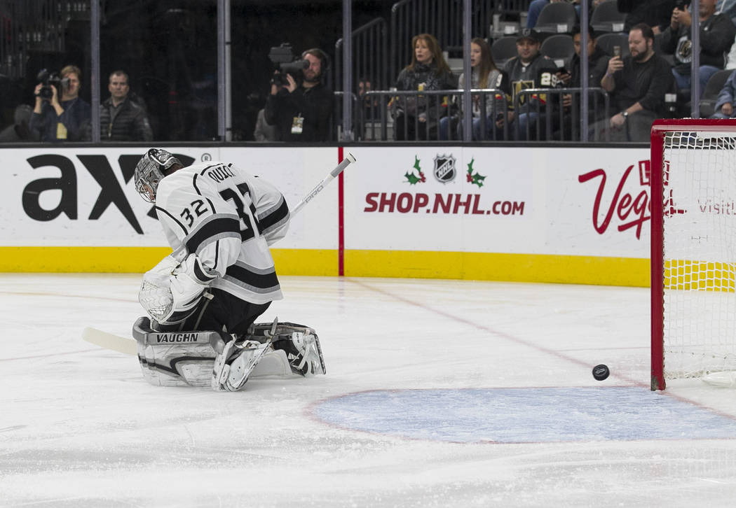 A goal from Vegas Golden Knights center William Karlsson gets past Los Angeles Kings goalie Jonathan Quick (32) during the first period of an NHL hockey game at the T-Mobile Arena in Las Vegas on  ...