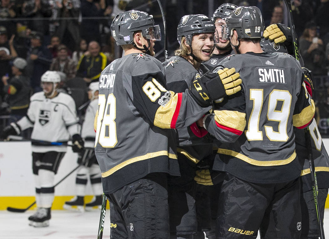 Vegas Golden Knights center William Karlsson, center, celebrates with teammates after scoring against the Los Angeles Kings during the first period of an NHL hockey game at the T-Mobile Arena in L ...