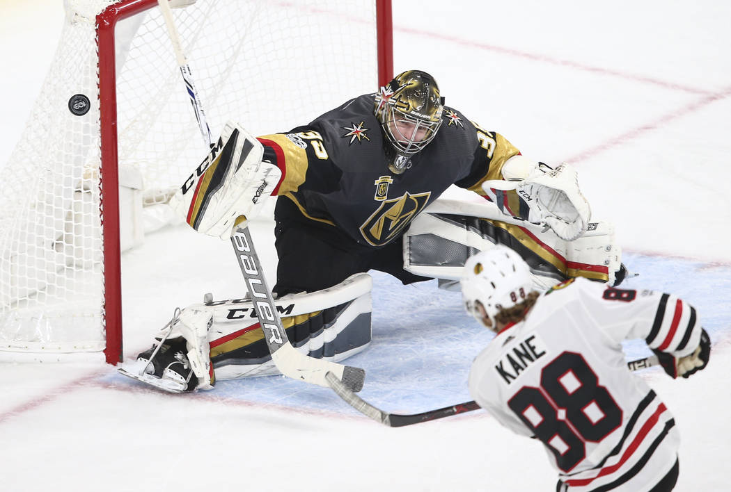 Golden Knights' goalie Oscar Dansk (35) blocks a shot from the Chicago Blackhawks during an NHL hockey game at T-Mobile Arena in Las Vegas on Tuesday, Oct. 24, 2017. Chase Stevens Las Vegas Review ...