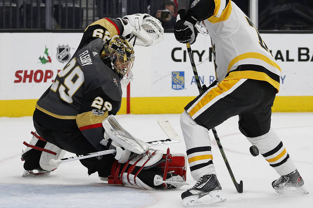 Vegas Golden Knights goalie Marc-Andre Fleury blocks a shot by Pittsburgh Penguins right wing Patric Hornqvist during the second period of an NHL hockey game Thursday, Dec. 14, 2017, in Las Vegas. ...