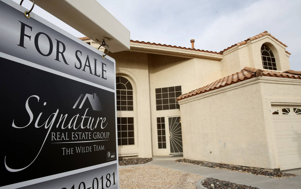 A for sale sign is displayed in front of a home at Gentle Bay Avenue near Windmill Lane Wednesday, Nov. 15, 2017, in Las Vegas. (Bizuayehu Tesfaye/Las Vegas Review-Journal @bizutesfaye)