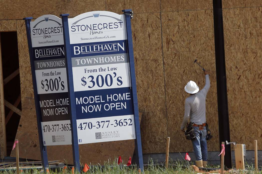 A construction worker continues work on new town homes under construction in Woodstock, Ga, Tuesday, May 16, 2017. The Standard & Poor's CoreLogic Case-Shiller home price index, which tracks t ...