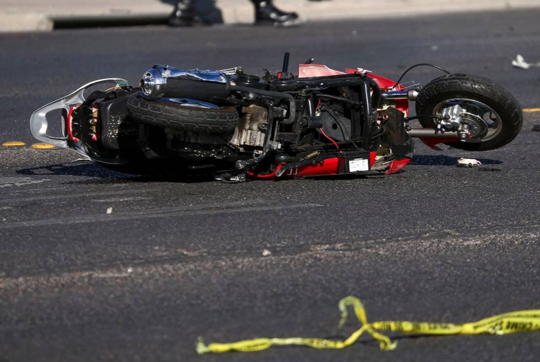 Police investigate a crash involving a scooter on Bonanza Road near Linn Lane in the northeastern part of Las Vegas on Tuesday, Dec. 26, 2017. Richard Brian Las Vegas Review-Journal @vegasphotograph