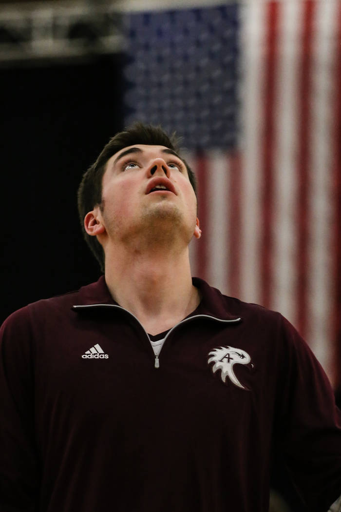 Augsburg Auggies' Carter Duncan (44) stands on the court before the start of a basketball game against the Carroll Pioneers in the D3Hoops.com Classic at the South Point Arena in Las Vegas, Thursd ...