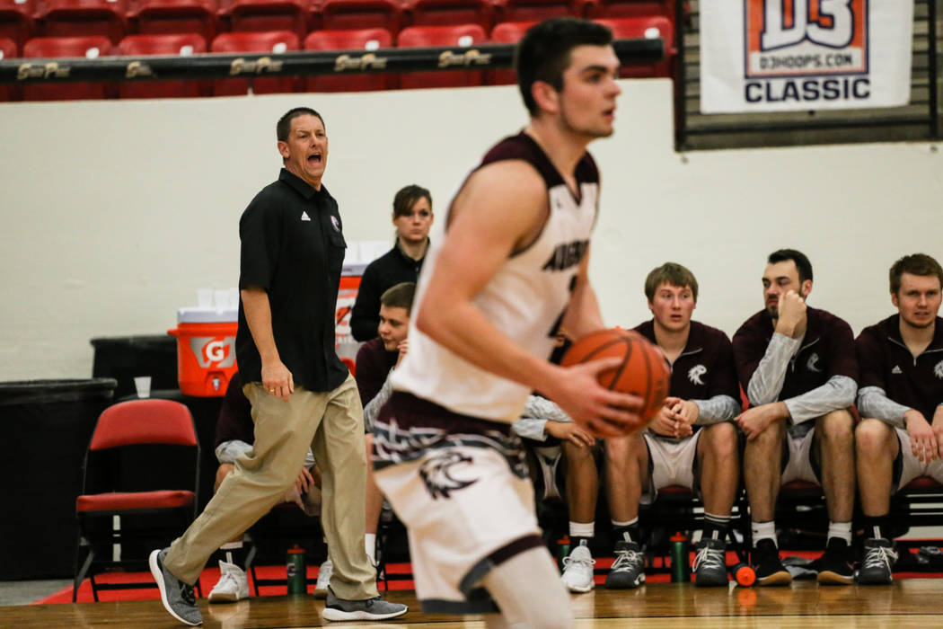Augsburg Auggies head coach Aaron Griess reacts during the first half of a basketball game against the Carroll Pioneers in the D3Hoops.com Classic at the South Point Arena in Las Vegas, Thursday,  ...