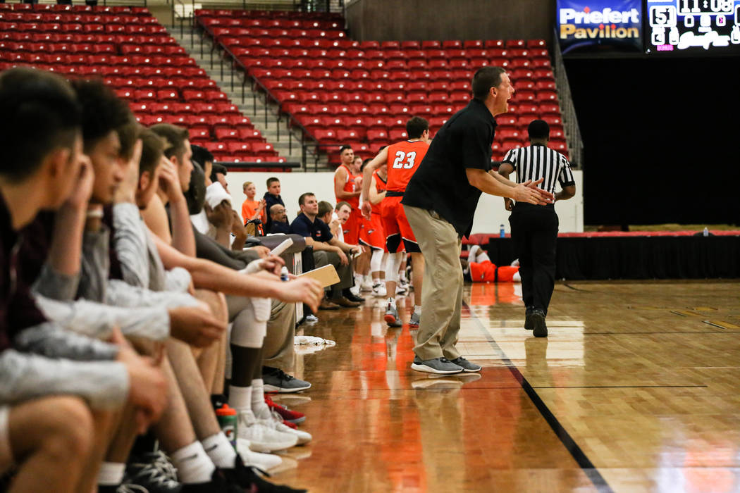 Augsburg Auggies head coach Aaron Griess reacts during the second half of a basketball game against the Carroll Pioneers in the D3Hoops.com Classic at the South Point Arena in Las Vegas, Thursday, ...