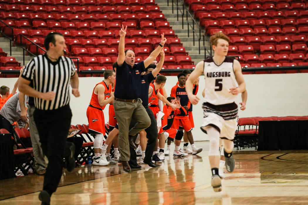 Carroll Pioneers head coach Paul Combs reacts after his team scored a point against the Augsburg Auggies during the second half of a basketball game in the D3Hoops.com Classic at the South Point A ...