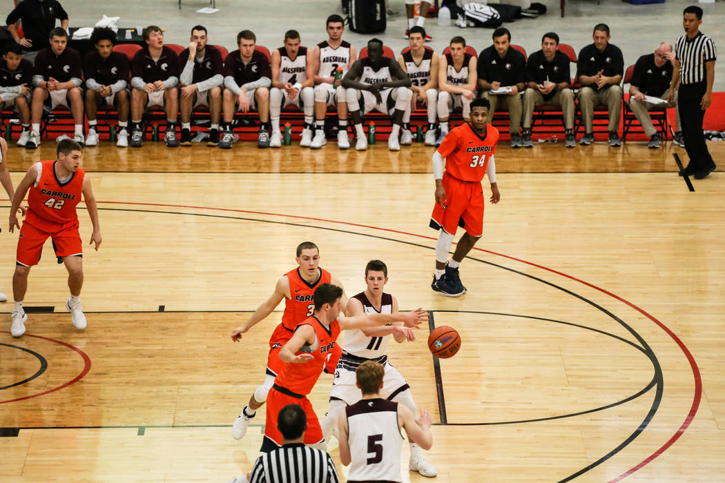 Augsburg Auggies' Kevin McKiernan (11) passes the ball to teammate Henry Mulligan (5) as Carroll PioneersÕ Justin Gruber (3), top left, and Troy Howat (10), bottom left, guard them during the ...