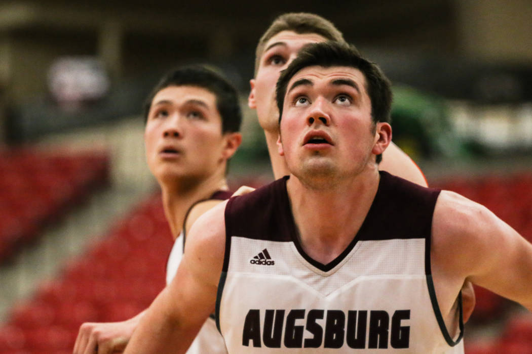 Augsburg Auggies' Carter Duncan (44) eyes a rebound during the first half of a basketball game against the Carroll Pioneers in the D3Hoops.com Classic at the South Point Arena in Las Vegas, Thursd ...