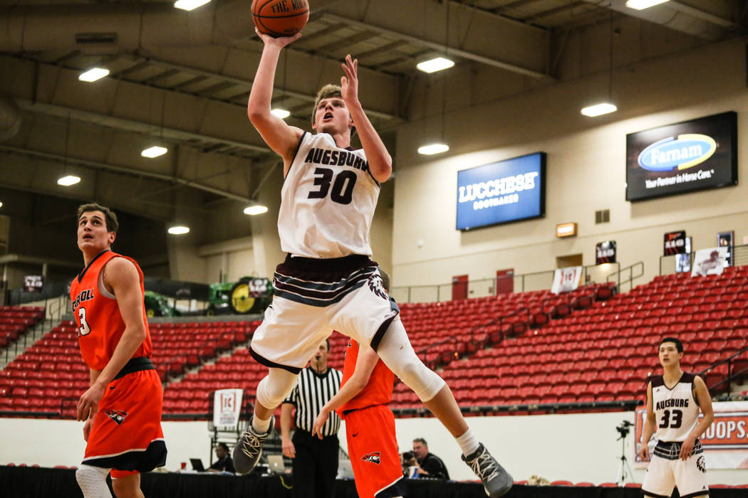 Augsburg Auggies' Booker Coplin (30) shoots the ball during the second half of a basketball game against the Carroll Pioneers in the D3Hoops.com Classic at the South Point Arena in Las Vegas, Thur ...