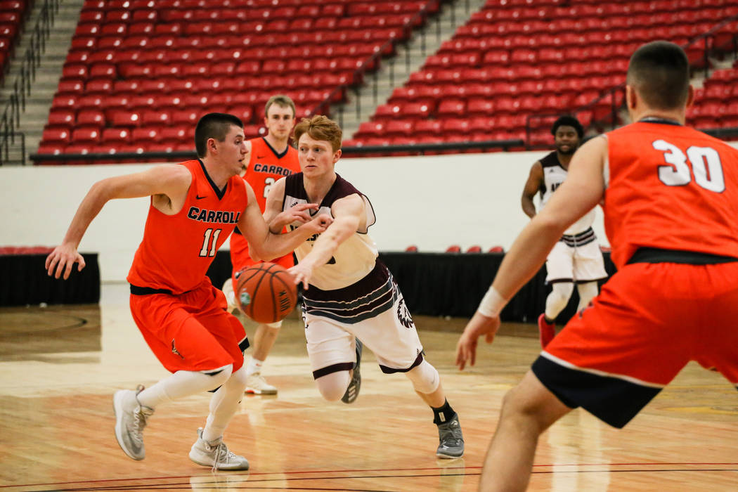 Carroll Pioneers' Ryan Clarey (11) guards Augsburg Auggies' Henry Mulligan (5) during the second half of a basketball game in the D3Hoops.com Classic at the South Point Arena in Las Vegas, Thursda ...