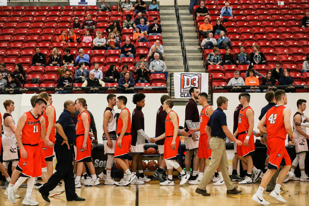 The Augsburg Auggies, back, and the Carroll Pioneers, front, shake hands at the end of a basketball game in the D3Hoops.com Classic at the South Point Arena in Las Vegas, Thursday, Dec. 28, 2017.  ...