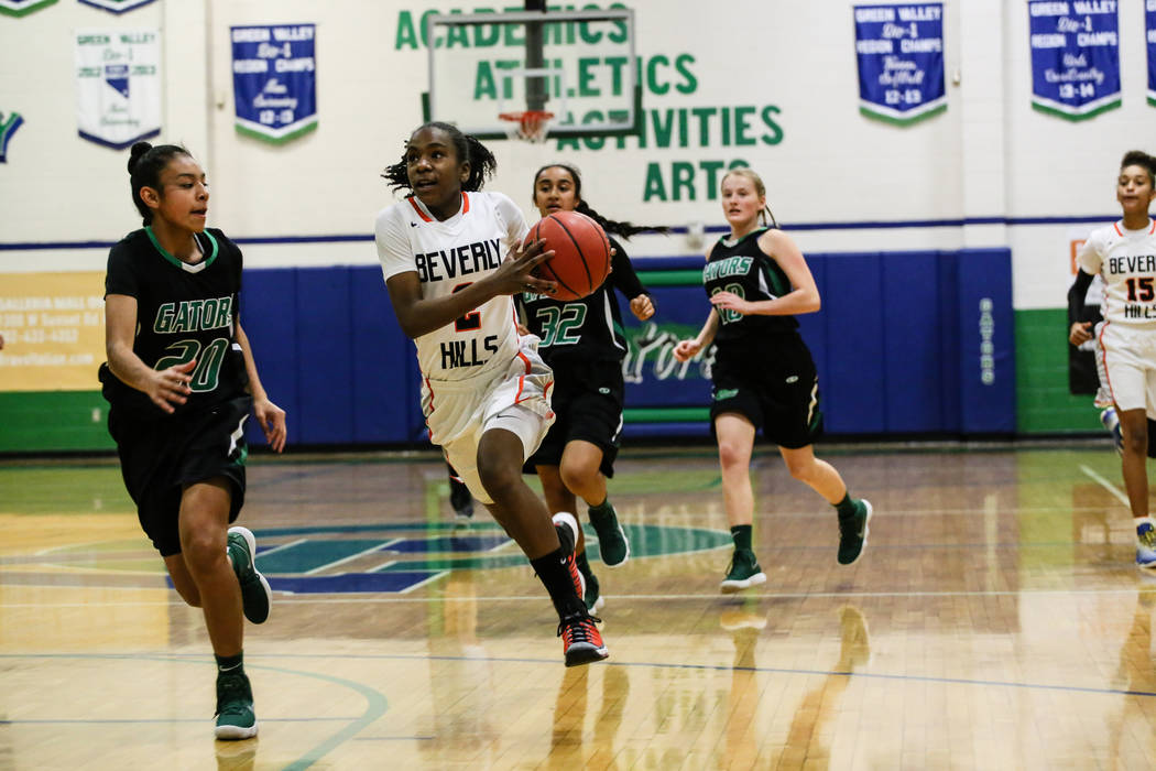Green Valley's Michelle Lagunas-Monroy (20) guards Beverly Hills' Arbri Gillis (2) during the first quarter of a basketball game during the Gator Winter Classic at Green Valley High School in Hend ...