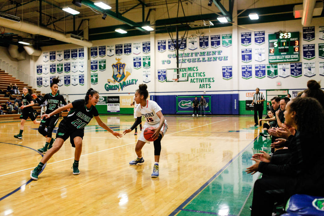 Green Valley's Michelle Lagunas-Monroy (20) guards Beverly Hills' Michelle Duchemin (15) during the first quarter of a basketball game during the Gator Winter Classic at Green Valley High School i ...