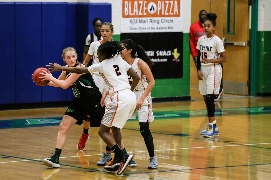 Green Valley's Julia Clark (10) is guarded by Beverly Hills' Arbri Gillis (2) during the second quarter of a basketball game during the Gator Winter Classic at Green Valley High School in Henderso ...