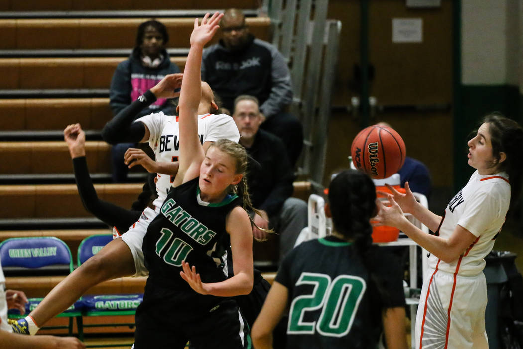 Green Valley's Julia Clark (10) jumps as her arm hits Beverly Hills' Michelle Duchemin (15) during the second quarter of a basketball game during the Gator Winter Classic at Green Valley High Scho ...