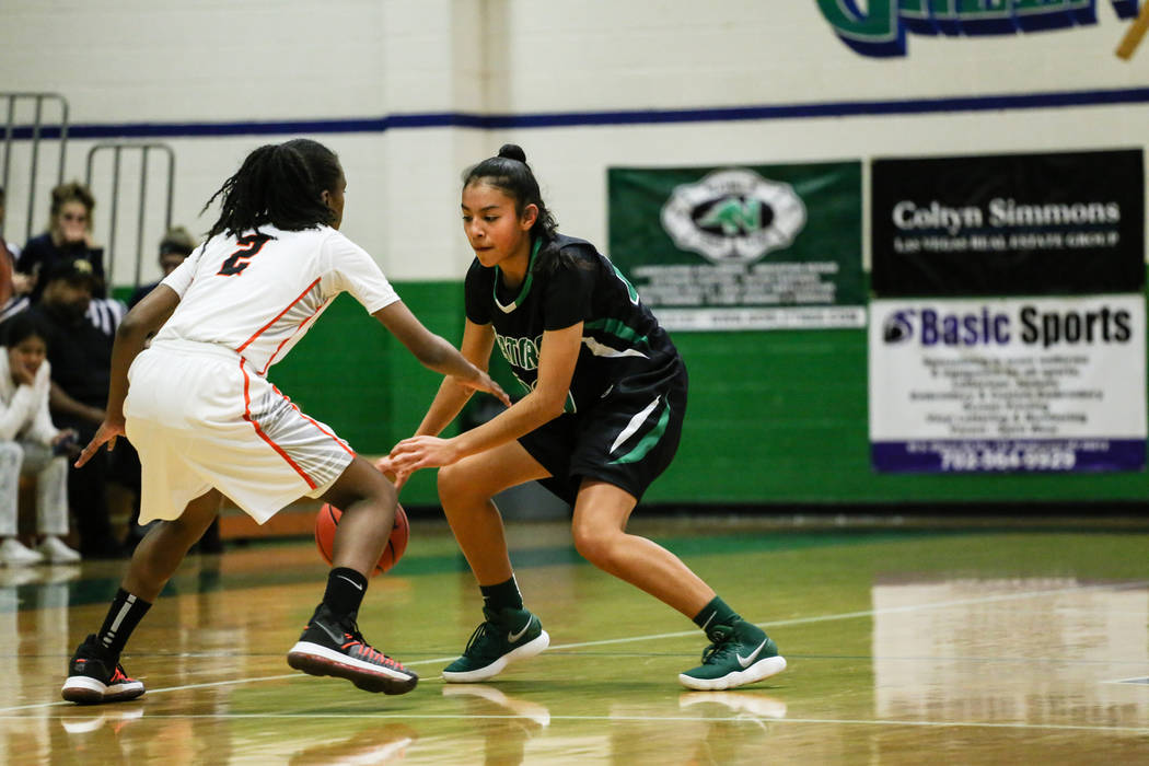 Beverly Hills' Arbri Gillis (2) guards Green Valley's Michelle Lagunas-Monroy (20) during the third quarter of a basketball game during the Gator Winter Classic at Green Valley High School in Hend ...