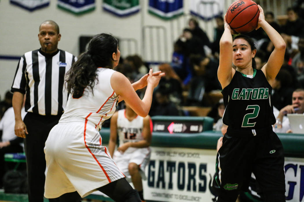 Beverly Hills' Megan Saghian (3) guards Green Valley's Gabriella Ghasserani (2) during the third quarter of a basketball game during the Gator Winter Classic at Green Valley High School in Henders ...