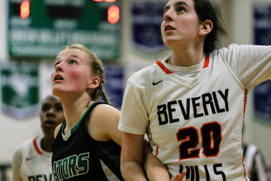 Green Valley's Julia Clark (10) and Beverly Hills' Isabel Rund (20) eye a rebound following a free-throw shot during the third quarter of a basketball game during the Gator Winter Classic at Green ...