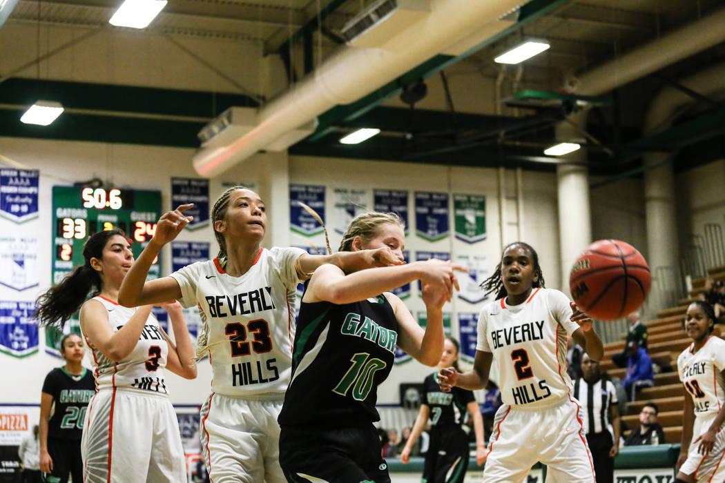 Beverly Hills' Megan Saghian (3), Beverly Hills' Emma Duchemin (23), Green Valley's Julia Clark (10) and Beverly Hills' Arbri Gillis (2) eye a loose ball during the third quarter of a basketball g ...