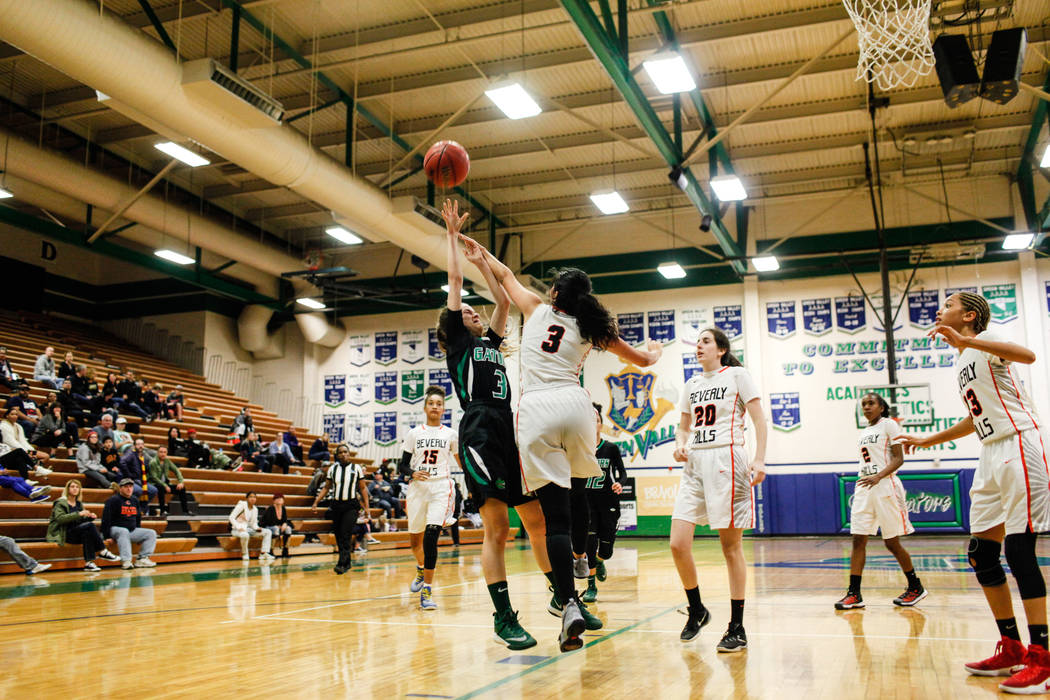 Green Valley's Temerity Bauer (3) is blocked by Beverly Hills' Megan Saghian (3) during the fourth quarter of a basketball game during the Gator Winter Classic at Green Valley High School in Hende ...