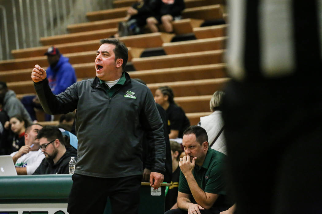 Green Valley head coach Eric Johnston reacts during the fourth quarter of a basketball game against Beverly Hills during the Gator Winter Classic at Green Valley High School in Henderson, Wednesda ...