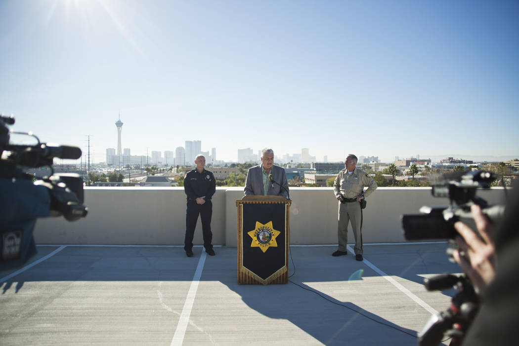 Clark County officials, from left, Fire Chief Greg Cassell, Commissioner Steve Sisolak, and Sheriff Joe Lombardo talk about New Year's Eve security during a news conference at Metropolitan Police  ...