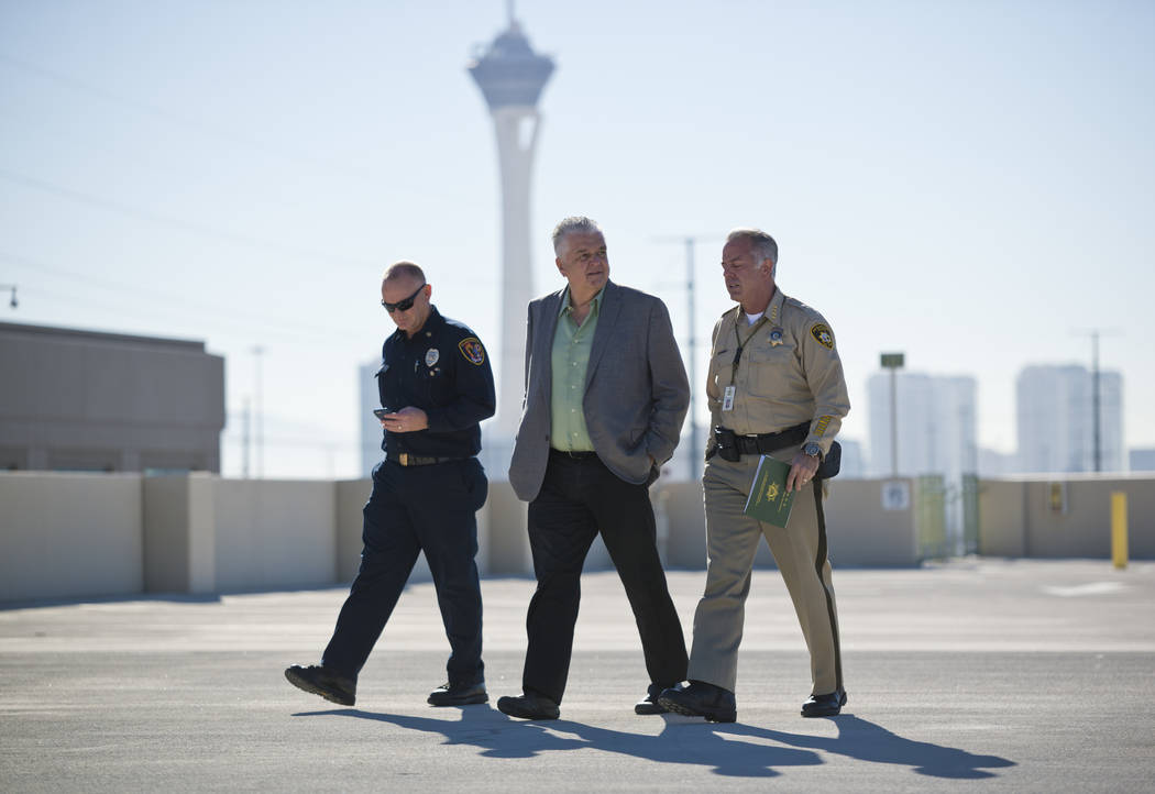 Clark County officials, from left, Fire Chief Greg Cassell, Commissioner Steve Sisolak, and Sheriff Joe Lombardo leave after a news conference on New Year's Eve security at the Las Vegas Metropoli ...