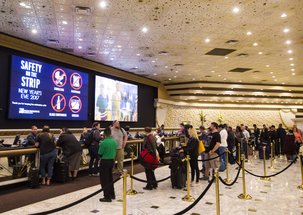 People line up to check-in at MGM Grand in Las Vegas on Wednesday, Dec. 27, 2017. Chase Stevens Las Vegas Review-Journal @csstevensphoto