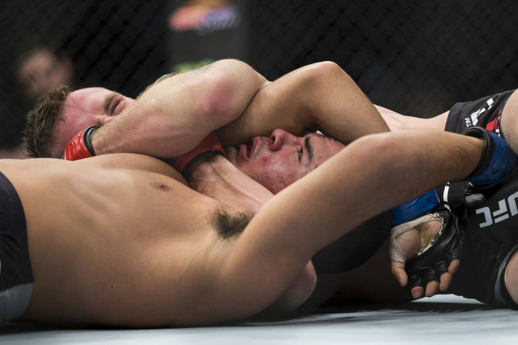 Tim Elliott, top, submits Mark De La Rosa in the second round of the bantamweight bout during UFC 220 at T-Mobile Arena in Las Vegas, Saturday, Dec. 30, 2017. Erik Verduzco/Las Vegas Review-Journal