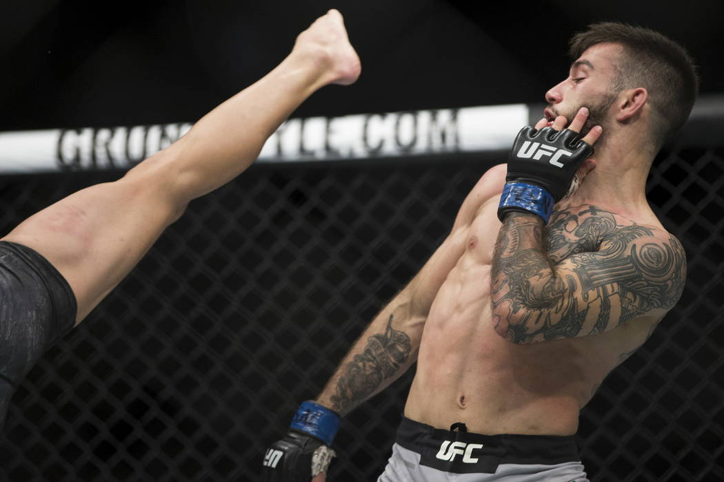 Matheus Nicolau, right, dodges a kick from Louis Smolka during the UFC 219 flyweight bout at T-Mobile Arena in Las Vegas, Saturday, Dec. 30, 2017. Nicolau won by unanimous decision. Erik Verduzco/ ...