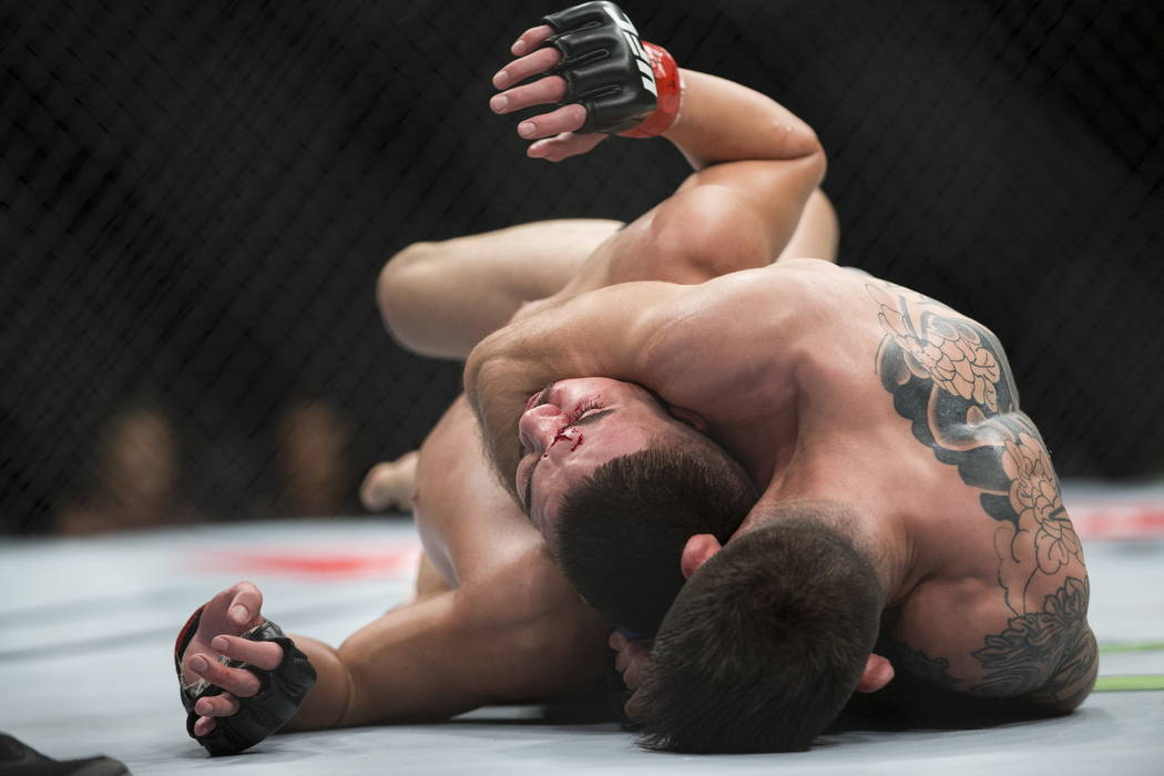 Matheus Nicolau, bottom, holds Louis Smolka in a headlock during the UFC 219 flyweight bout at T-Mobile Arena in Las Vegas, Saturday, Dec. 30, 2017. Nicolau won by unanimous decision. Erik Verduzc ...