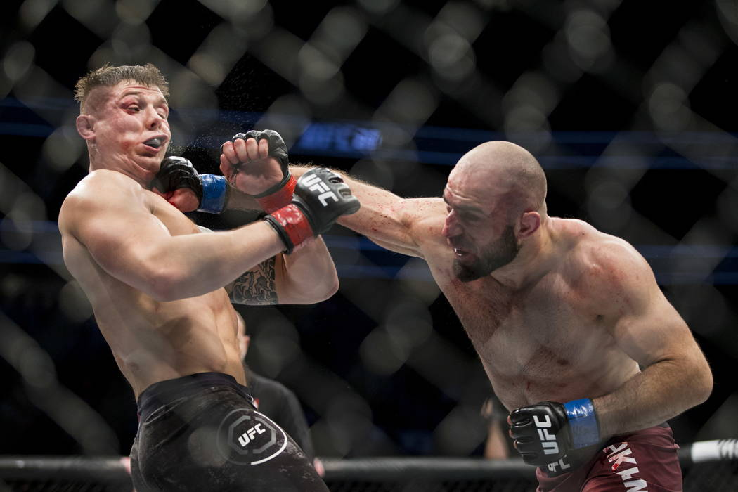 Omari Akhmedov, right, connects a punch against Marvin Vettori in the UFC 219 middleweight bout at T-Mobile Arena in Las Vegas, Saturday, Dec. 30, 2017. The fight ended in a split draw. Erik Verdu ...