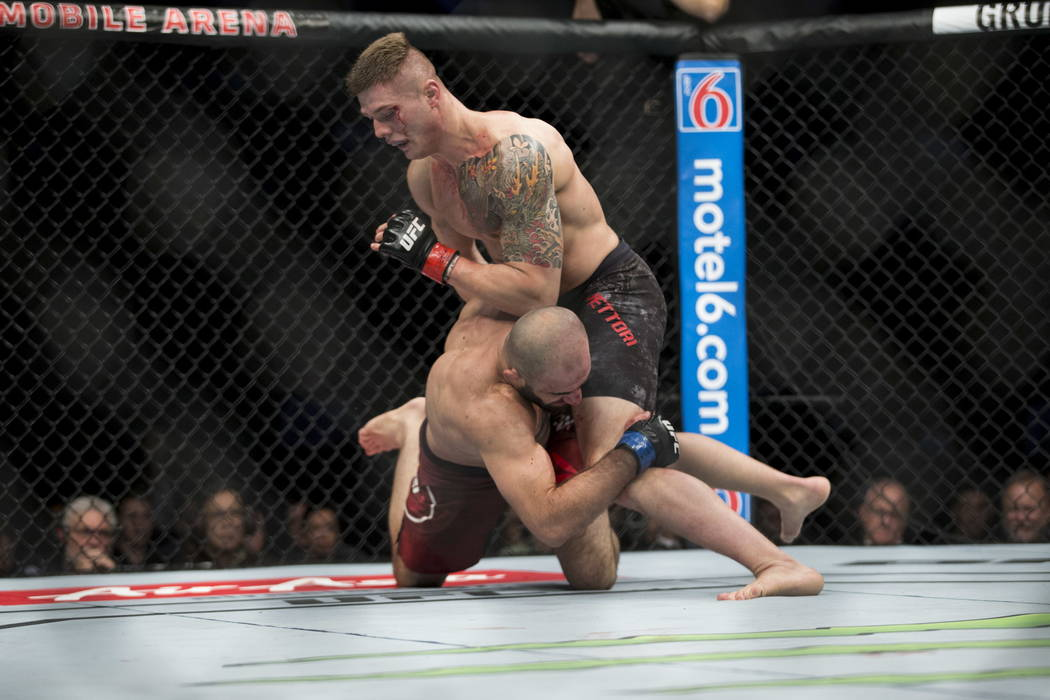 Marvin Vettori, top, battles Omari Akhmedov in the UFC 219 middleweight bout at T-Mobile Arena in Las Vegas, Saturday, Dec. 30, 2017. The fight ended in a split draw. Erik Verduzco/Las Vegas Revie ...