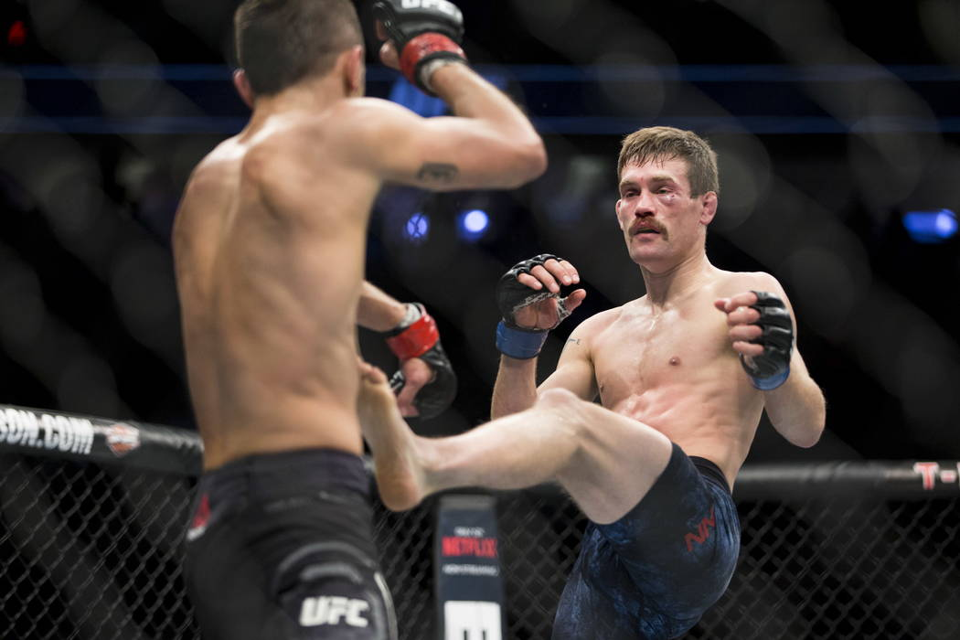 Myles Jury, left, battles Rick Glenn in the UFC 219 featherweight bout at T-Mobile Arena in Las Vegas, Saturday, Dec. 30, 2017. Jury won by unanimous decision. Erik Verduzco/Las Vegas Review-Journal