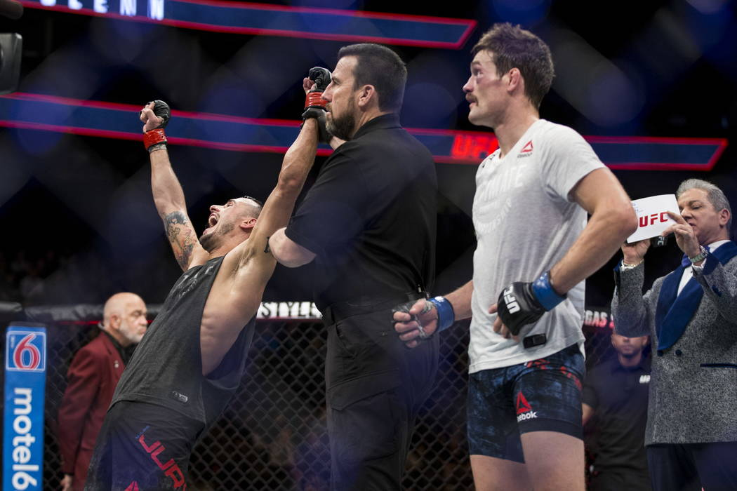 Myles Jury, left, reacts after he was announced the winner against Rick Glenn in the UFC 219 featherweight bout at T-Mobile Arena in Las Vegas, Saturday, Dec. 30, 2017. Jury won by unanimous decis ...
