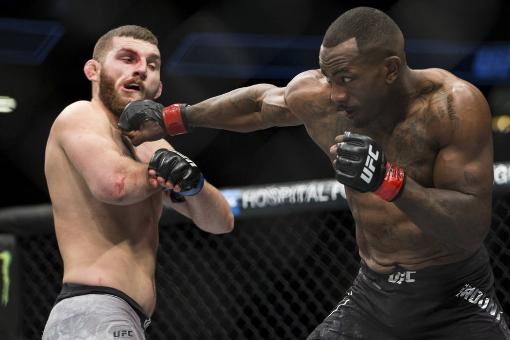 Khalil Rountree, right, connects a punch against Michal Oleksiejczuk in the light heavyweight bout at T-Mobile Arena in Las Vegas, Saturday, Dec. 30, 2017. Oleksiejczuk won by unanimous decision.  ...