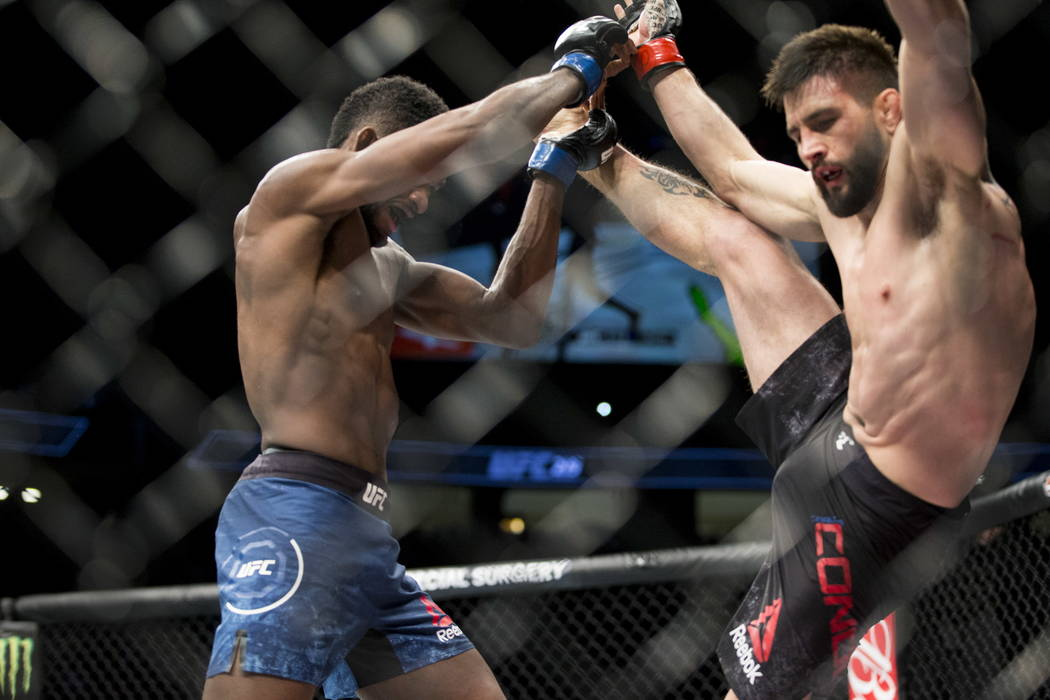 Neil Magny, left, battles Carlos Condit in the UFC 219 welterweight bout at T-Mobile Arena in Las Vegas, Saturday, Dec. 30, 2017. Magny won by unanimous decision. Erik Verduzco/Las Vegas Review-Jo ...
