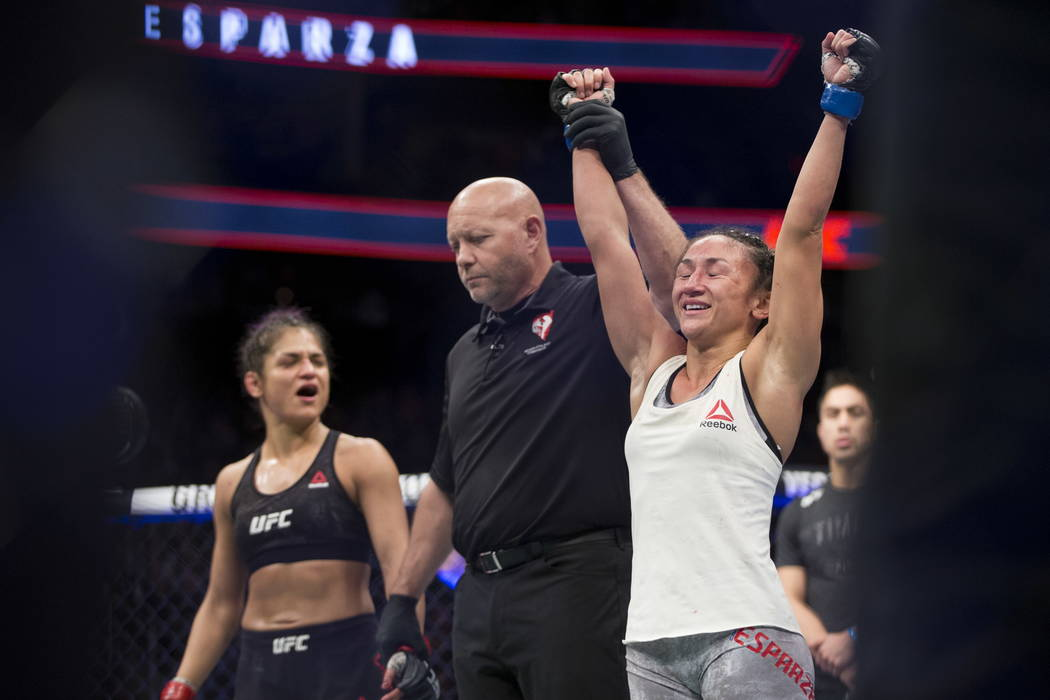 Cynthia Calvillo, right, reacts after she was announced the winner against Carla Esparza in the UFC 219 women's strawweight bout at T-Mobile Arena in Las Vegas, Saturday, Dec. 30, 2017. Esp ...