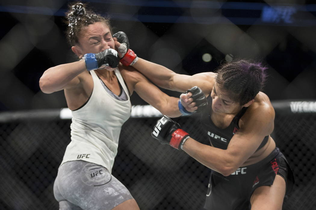 Carla Esparza, left, battles Cynthia Calvillo in the UFC 219 women's strawweight bout at T-Mobile Arena in Las Vegas, Saturday, Dec. 30, 2017. Esparza won by unanimous decision. Erik Verduz ...